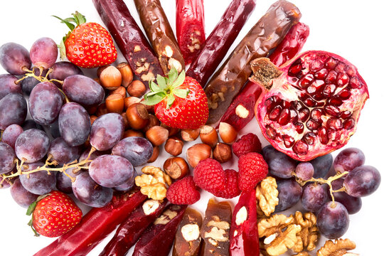 Churchkhela mix, fruits, berries and nuts on a white table, food background, Caucasian sweets