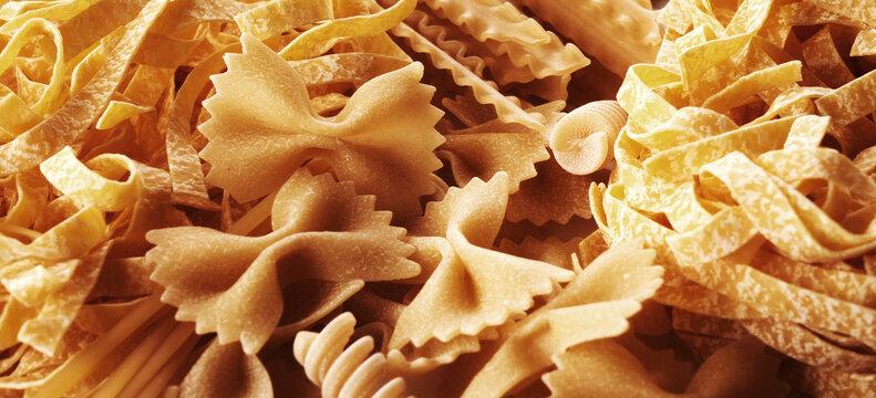Assorted varieties of pasta background. Mix macaroni