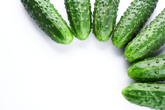 Set of fresh whole cucumbers on white background, food pattern. Garden cucumber wallpaper backdrop design