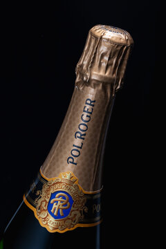 The detail of bottle Pol Roger champagne  on the black  background.