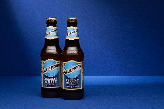 Two Blue Moon Wheat Beers on the blue background.