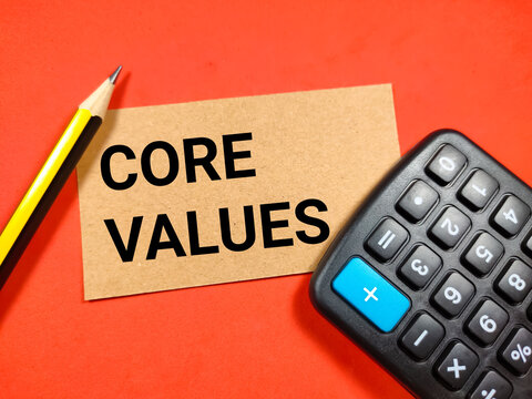 Selective focus of pencil and calculator with text CORE VALUES on red background.Business concept.