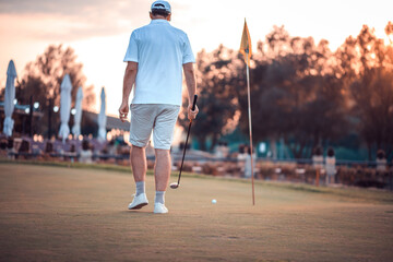 Senior golfer on court.