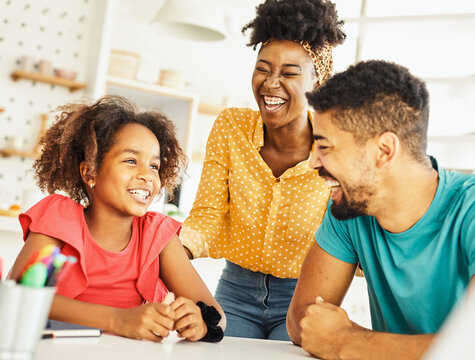 child family woman home happy man father mother lifestyle happiness daughter  together parent love bonding cheerful fun table