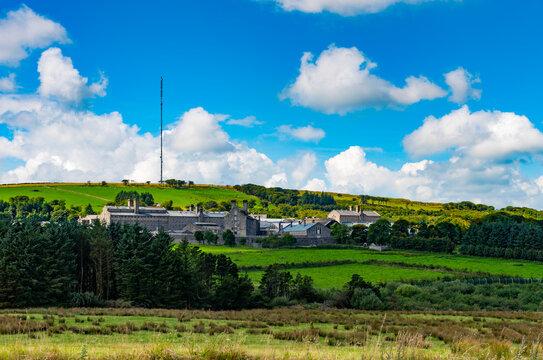 View over Dartmoor towards H.M. Prison, Princetown, Devon, England, UK