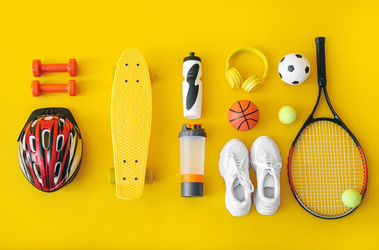 Set of sport equipment on color background