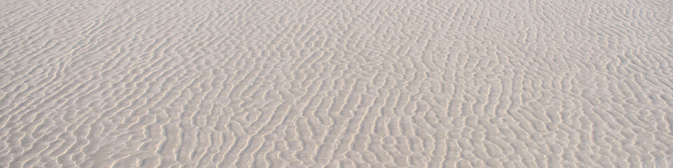 Tło, piasek morski, Falisty wzór. Abstrakcja
