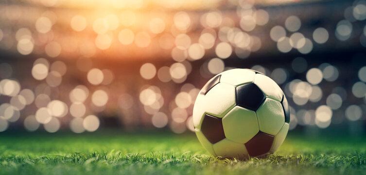 Football soccer ball on grass field on stadium