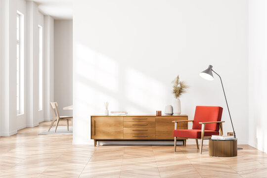 Bright contemporary waiting room interior with wooden sideboard