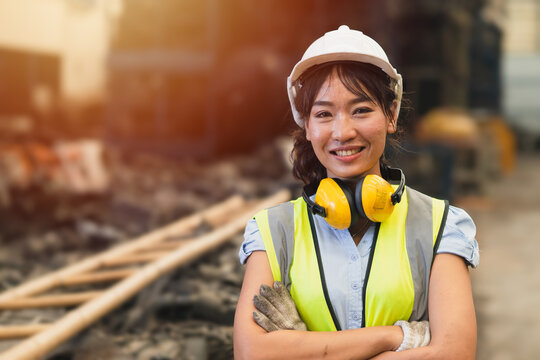 Happy women engineer Asian worker female work in factory portrait smile standing arm fold confidence look