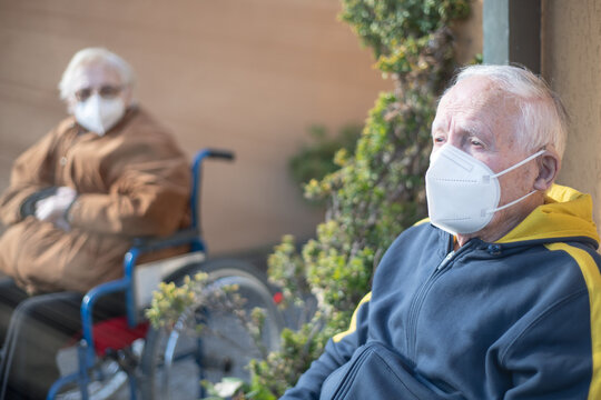 Elderly man and woman waiting outdoor to receive Covid-19 Vaccine, thinking about possible side effects