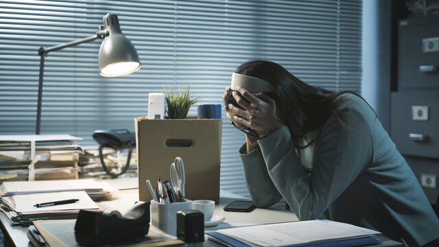 Desperate woman crying in the office after losing her job