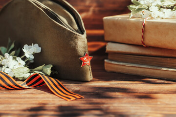 Fototapeta 9 may holiday victory day. George ribbon and military cap. obraz