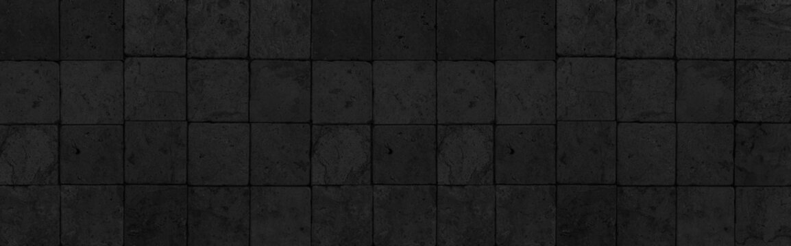 Panorama of Outdoor black block stone floor pattern and background seamless