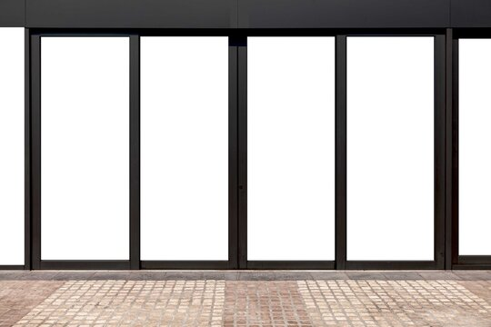 Large aluminum door frames and brown stone floor at the entrance to the building