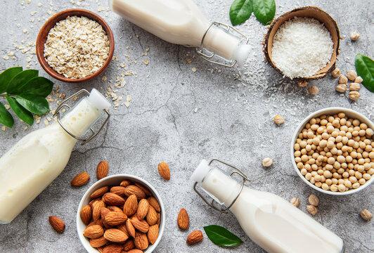 Alternative types of vegan milks in glass bottles