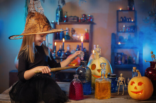beautiful little witch with Halloween decorations