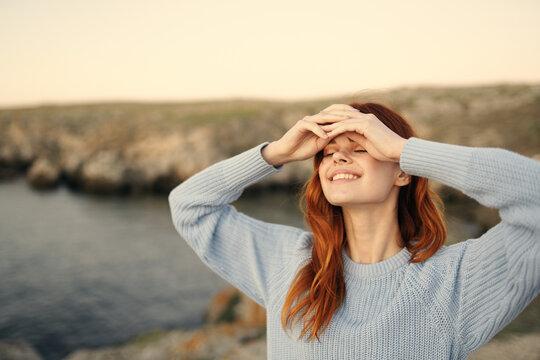 pretty woman in blue sweater enjoy nature fresh air freedom