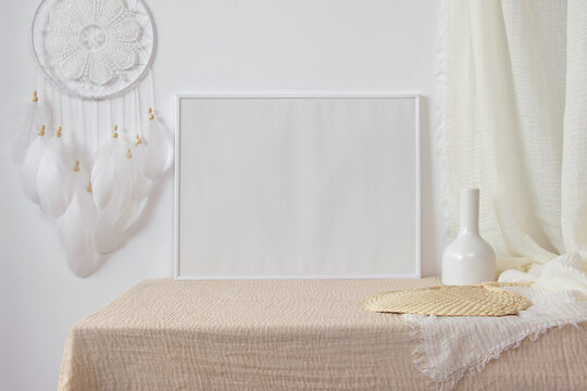 4x3 white photo frame mockup with dreamcatcher and vase