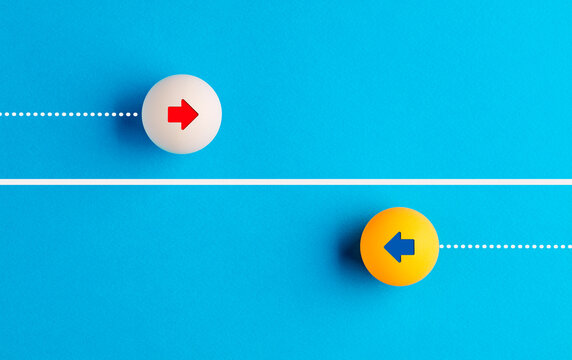 Arrow icons in contrast on table tennis balls moving towards opposite directions.