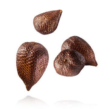 Fresh ripe salak ar snake fruit falling in the air