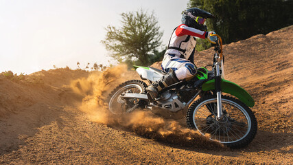 Wall Murals Wall Decor With Your Own Photos Young man practice riding dirt bike.Splashing sand