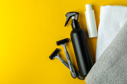 Concept of men's hygiene tools on yellow background