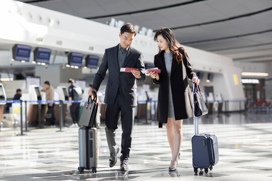 Successful business people with luggage at airport