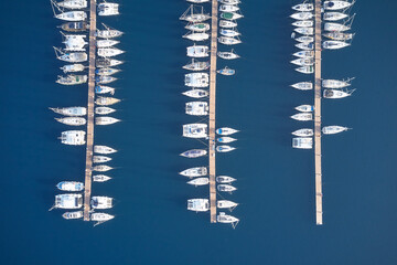 Fototapeta Top view of boats on blue water surface.