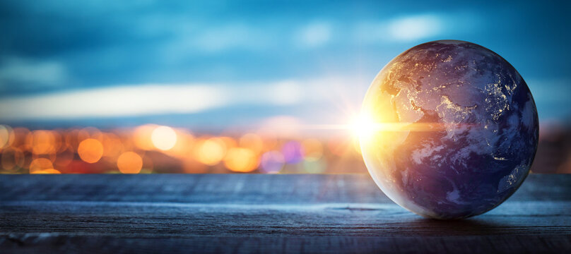 Planet earth on the background of blurred lights of the city. Concept on business, politics, ecology and media.  Elements of this image furnished by NASA