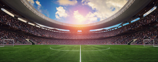 Fototapeta a soccer stadium in the summer in the sun