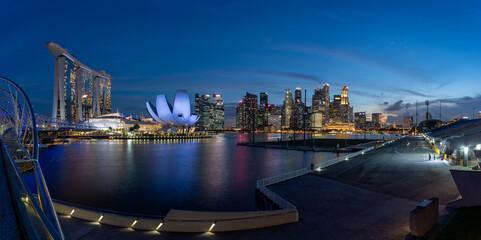 Super wide image of Singapore Marina Bay Area at magic hour.