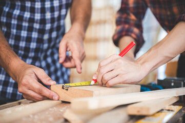 Fototapeta professional carpenters woodworking team work together creatively, creative carpenter working workshop for wooden craftman with wood obraz