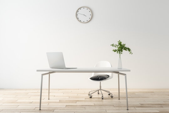 Stylish minimalistic design work space with laptop on light table, wooden floor and wall clock on white background wall