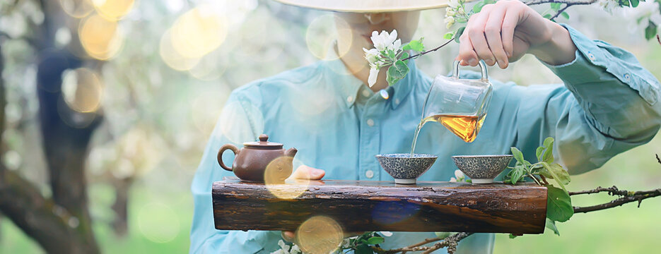 spring tea ceremony in asia, abstract fresh garden background man master