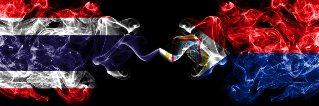 Thailand, Thai vs Netherlands, Dutch, Holland, Sint Maarten smoky mystic flags placed side by side. Thick colored silky abstract smokes flags.