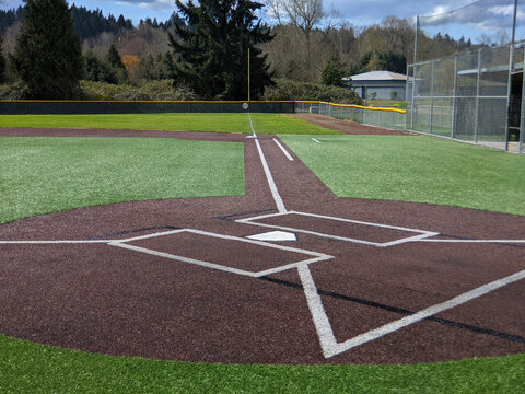 a large, empty baseball field on a bright, sunny day