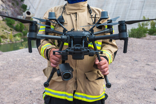 firefighter operating drone in search and rescue