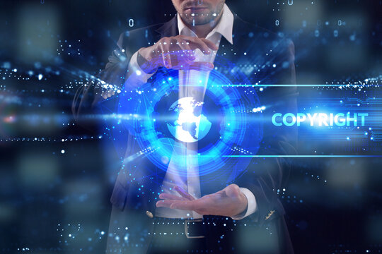 Business, Technology, Internet and network concept. Young businessman working on a virtual screen of the future and sees the inscription: Copyright
