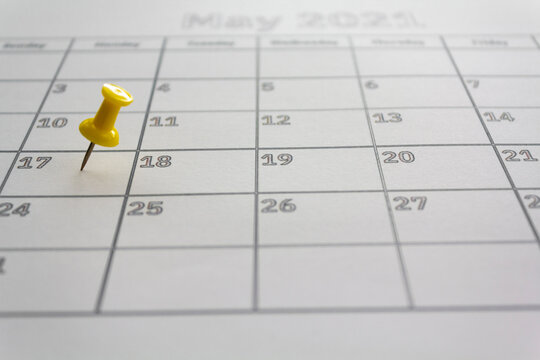 Calendar with pushpin in May 17 2021 to illustrate the new extended date for IRS Federal Income Tax Returns. USA Tax deadline concept