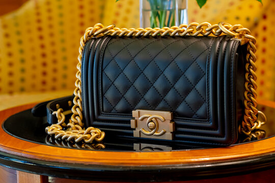 Venice, Italy Jun8 2019: black leather Chanel bag Chanel boy 8 inch.  Classic luxury style gold chain
