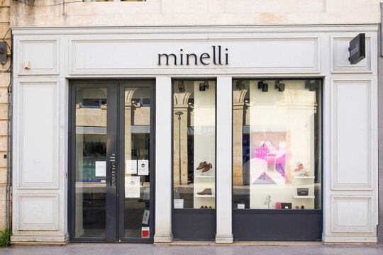 Minelli sign logo and text shop chain of fashion retailers shoes brand boutique