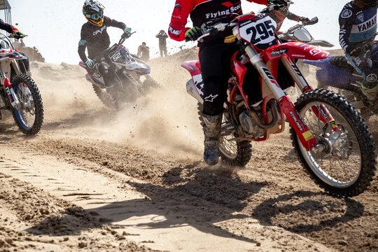 DUBAI, UNITED ARAB EMIRATES - Jan 30, 2021: Motocross riders and motor bikes on track