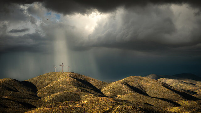 Sunlight beaming down on three Crosses on a Hill, Lake Elsinore, California, USA