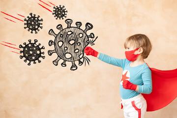 Superhero child beat drawing virus