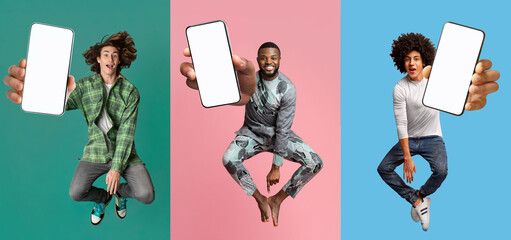 Wall Murals Cool young guys with empty smartphones jumping up in air over colorful studio backgrounds, mobile application mockup