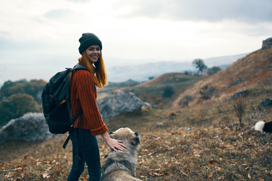 women hikers tivikom nature mountains landscape travel playing dogs