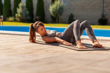 Woman doing sit ups while working out Wall mural