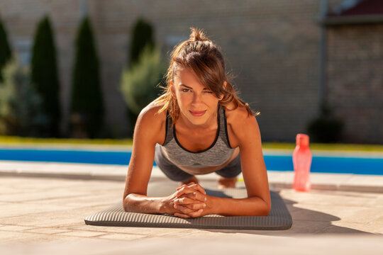 Woman doing forearm plank exercise