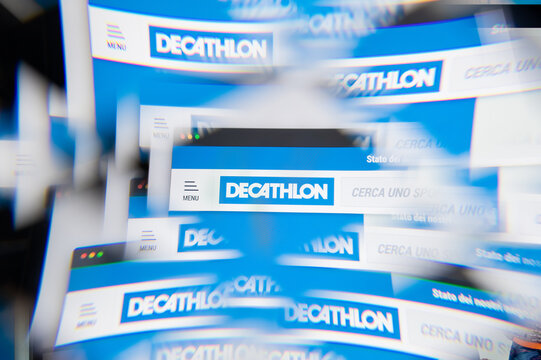 Milan, Italy - APRIL 10, 2021: Decathlon logo on laptop screen seen through an optical prism. Illustrative editorial image from Decathlon website.